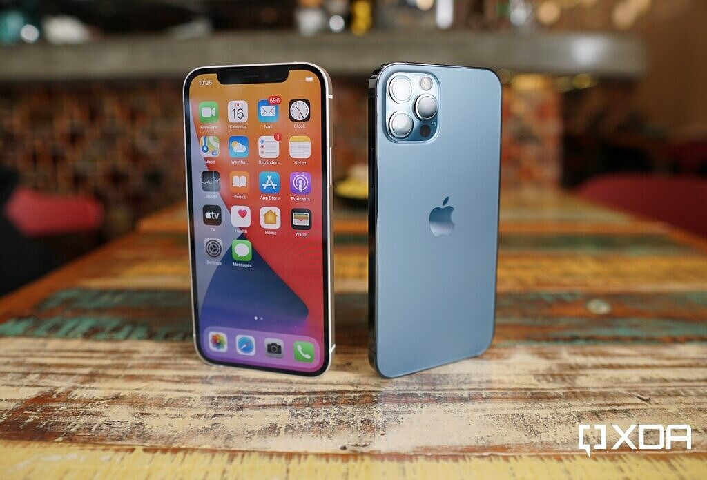 Apple iPhone 12 Front and Apple iPhone 12 Pro Blue standing on a table