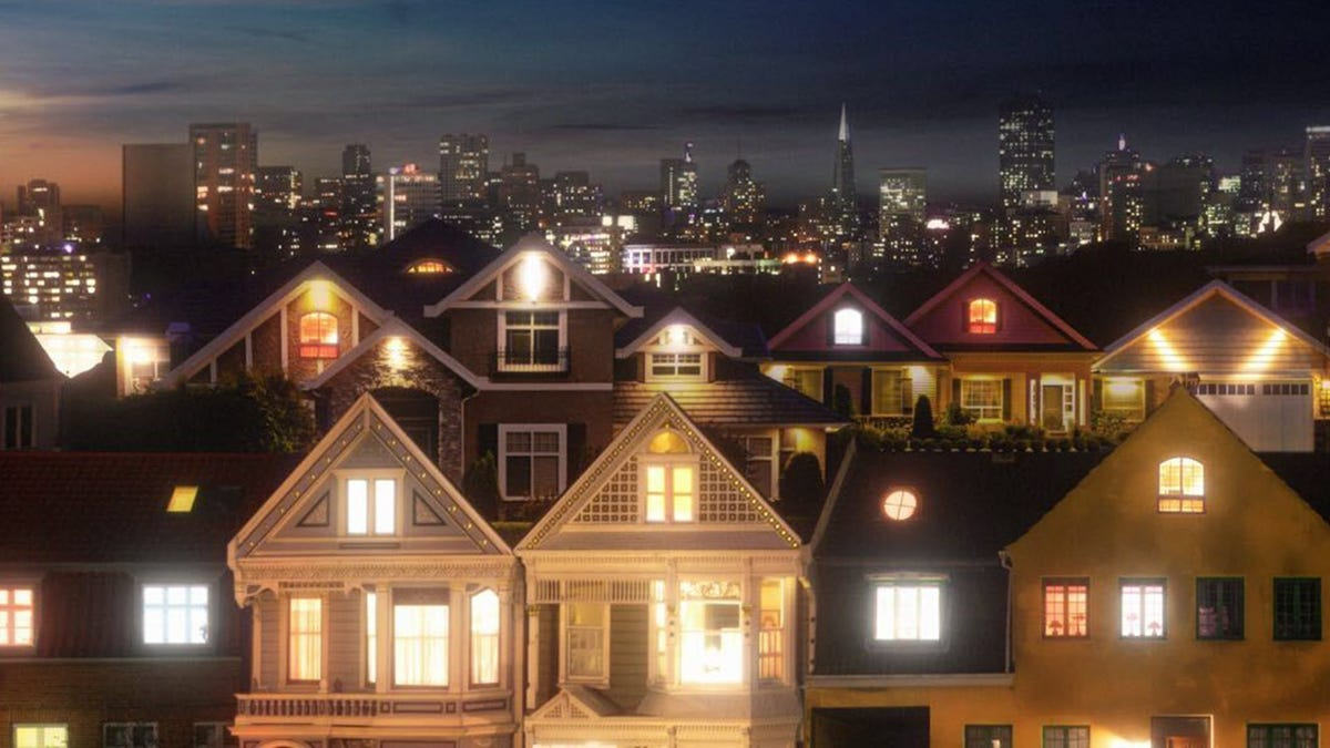 A street full of homes at night.