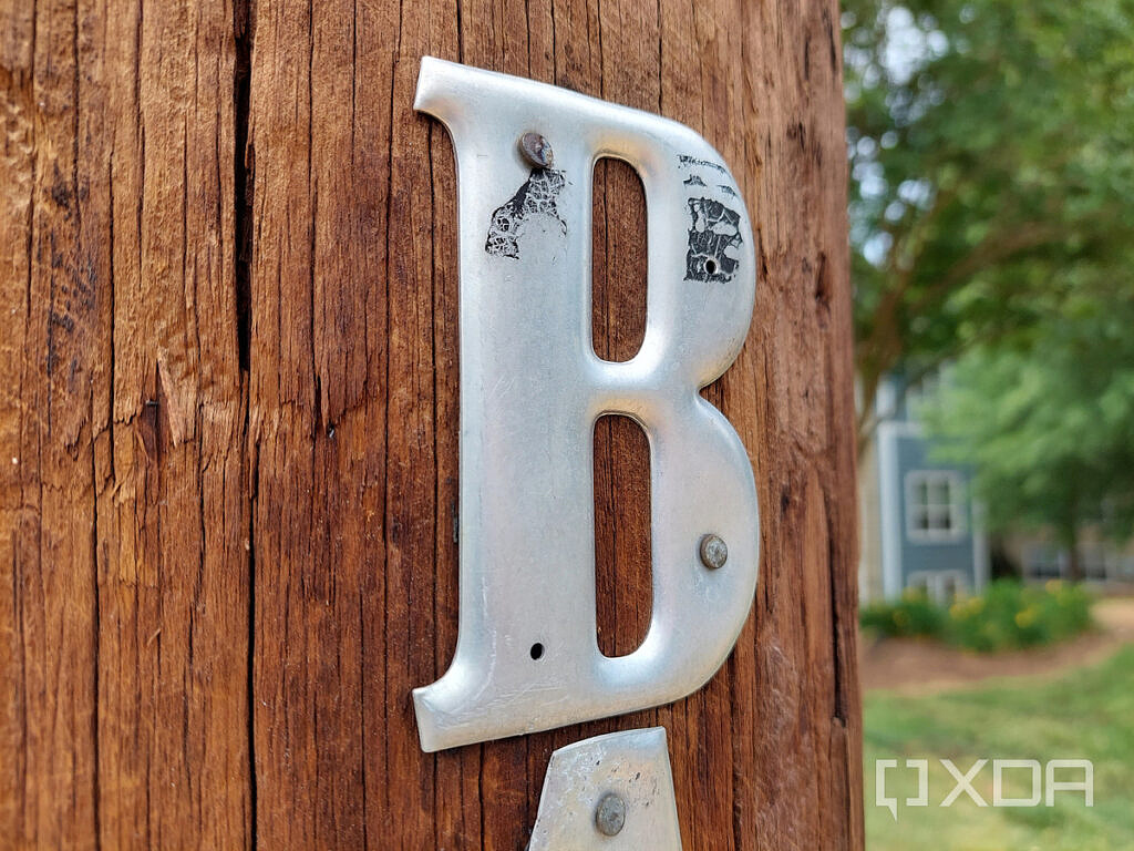 Photo of a letter 'B' on a wooden post