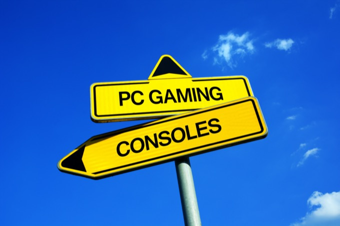 PC Gaming vs Consoles - Traffic sign with two options - gamer and playing video games on personal computer or on console. Question of hardware and performance