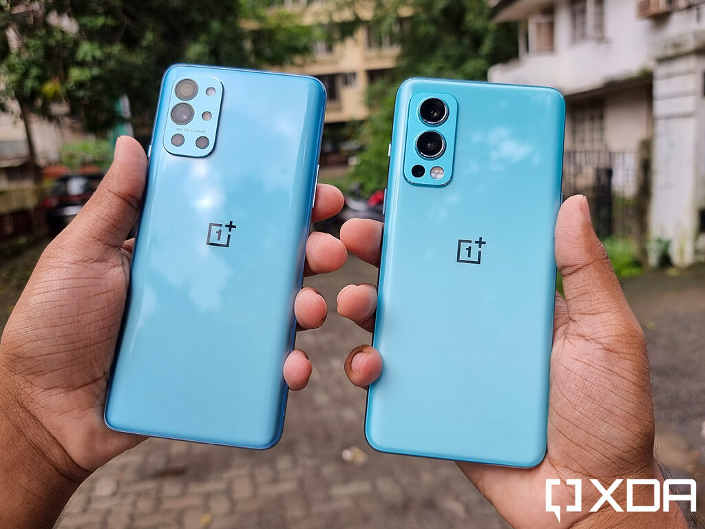 OnePlus 9R and OnePlus Nord 2 held out in hand to show the difference in their blue colors