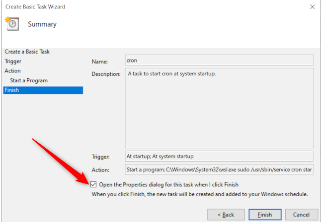 Windows 10's Task Scheduler's final task creation window with a red arrow pointing to the option to open the task properties window at finish.