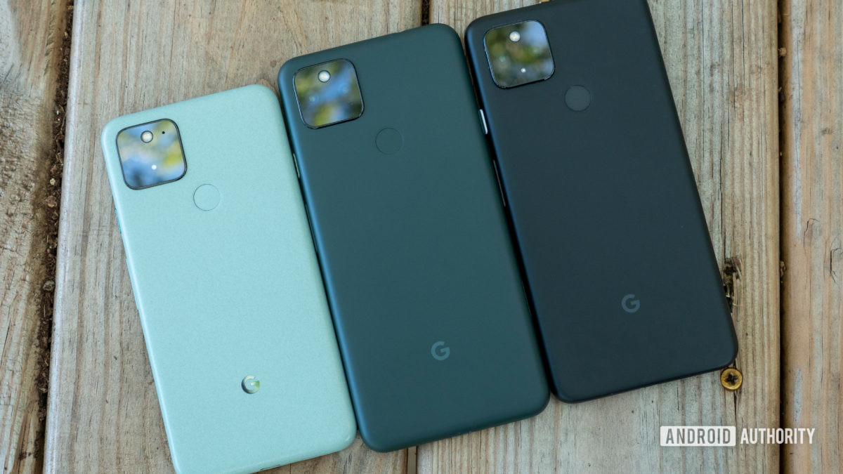 the google pixel 5a on a bench compared to the pixel 5 and pixel 4a 5g with back panels showing