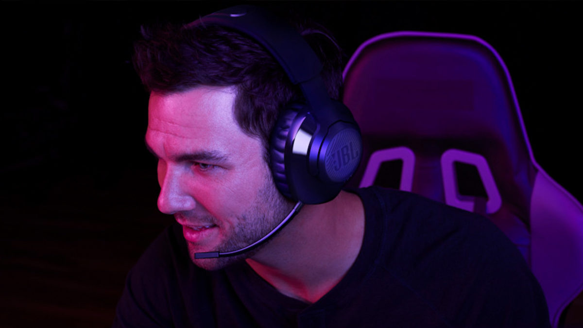 A man games with the JBL Quantum 350 Wireless headset and attached boom microphone.