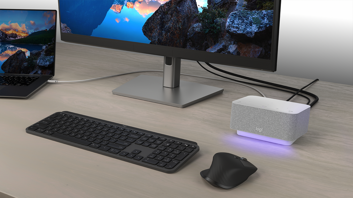 The Logi Dock lit up for a video meeting notification.